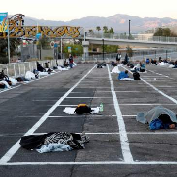 People sleep in spaces at a temporary homeless shelter at Cashman Center in Las Vegas, Nevada, March 29, 2020.People sleep in spaces at a temporary homeless shelter at Cashman Center in Las Vegas, Nevada, March 29, 2020. MediaPunch/Rex/Shutterstoc
